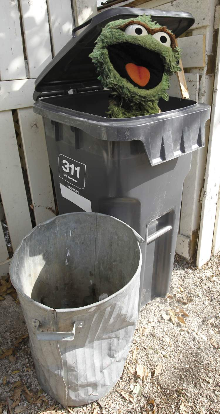 Garbage Cans And Blue Boxes Are Out Automated Carts Are In