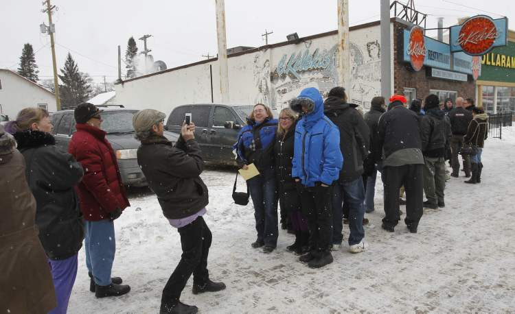 About 40 people were waiting outside the C. Kelekis Restaurant on Main Street before it opened at 11 a.m. Tuesday.
