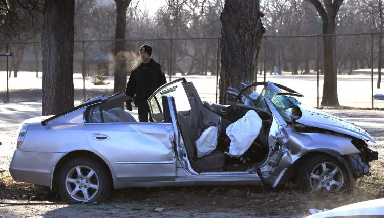 Winnipeg police were at a crash scene Friday morning on north Main Street. The small car was heading north when it left the road, struck a tree on the boulevard and crashed into a fence that runs alongside a fairway.