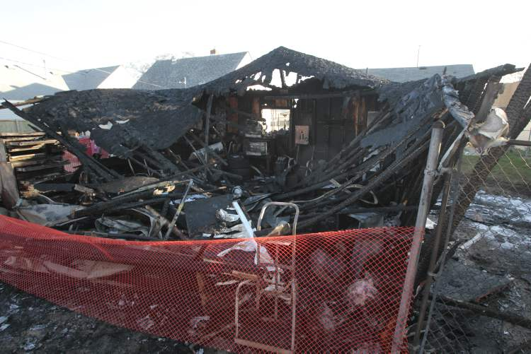 An overnight fire gutted a garage behind a home in the 1600 block of Logan Avenue.