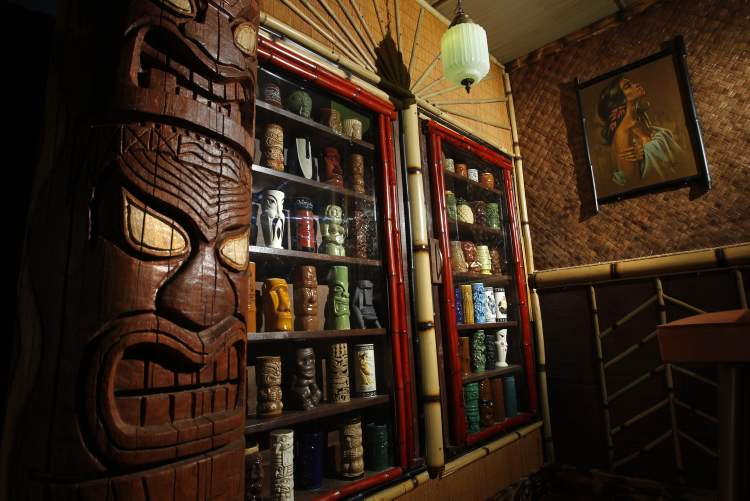 Some of Ron's mug collection is on display in a cabinet.  (WAYNE GLOWACKI / WINNIPEG FREE PRESS)