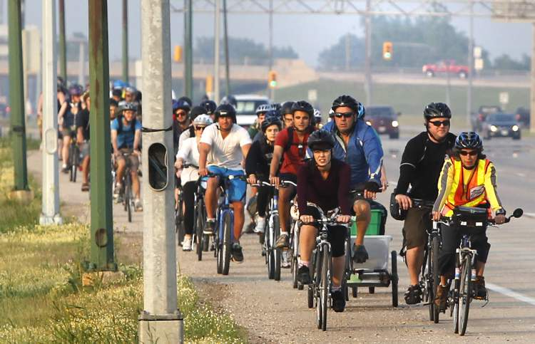 WEDNESDAY, JULY 10 — About 300 cyclists head north on Hwy. 59 to Birds Hill Provincial Park then to the Festival Campground to set up their camping spots.