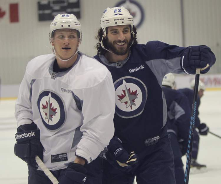 Ivan Telegin (left) and Chris Thorburn chat during practice. (Wayne Glowacki / Winnipeg Free Press)