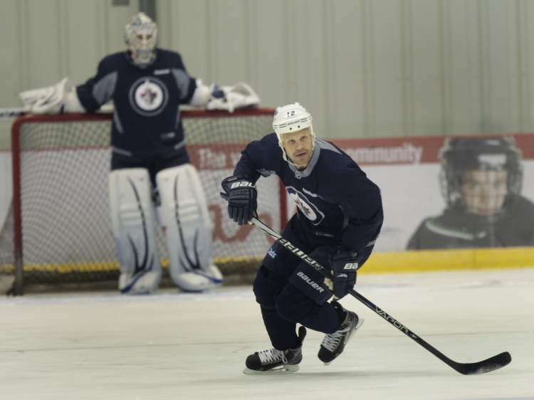 Olli Jokinen (right) skates at practice.