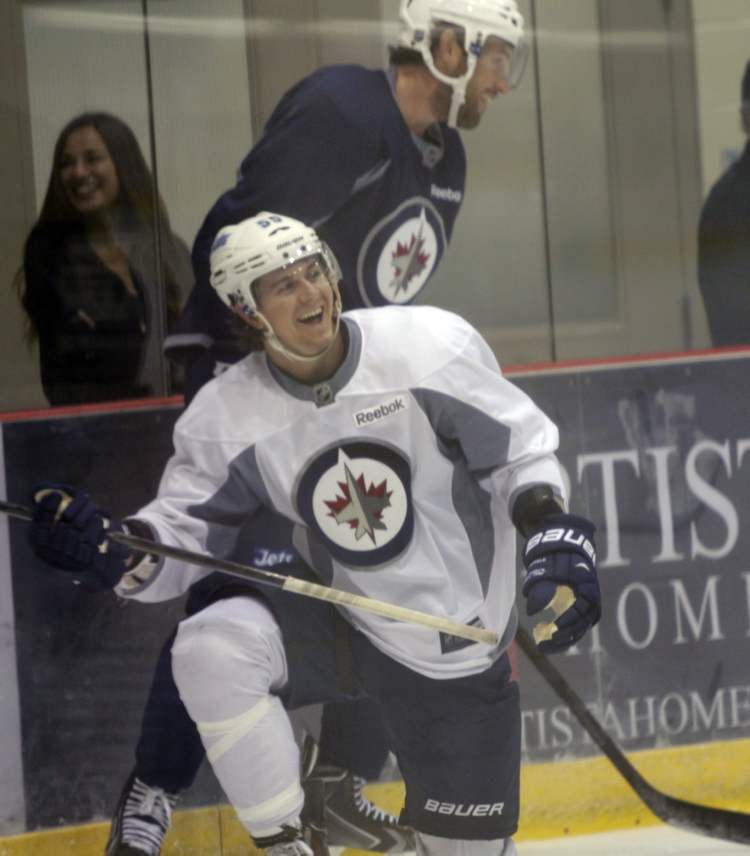 Some Winnipeg Jets players and rookies took part in an informal practice at the MTS Iceplex Wednesday morning. Among them were Winnipeg Jets forward Mark Scheifele (kneeling). (Wayne Glowacki / Winnipeg Free Press)