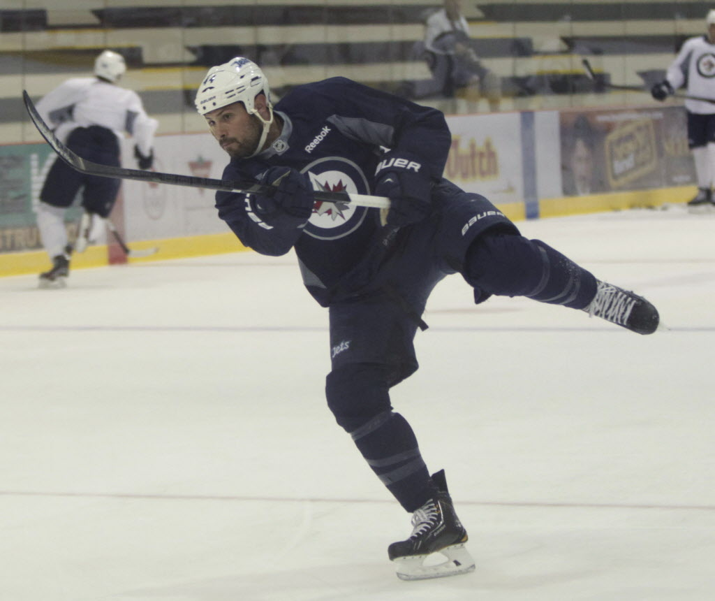 Defenceman Zach Bogosian takes a shot at the informal Winnipeg Jets practice Wednesday.