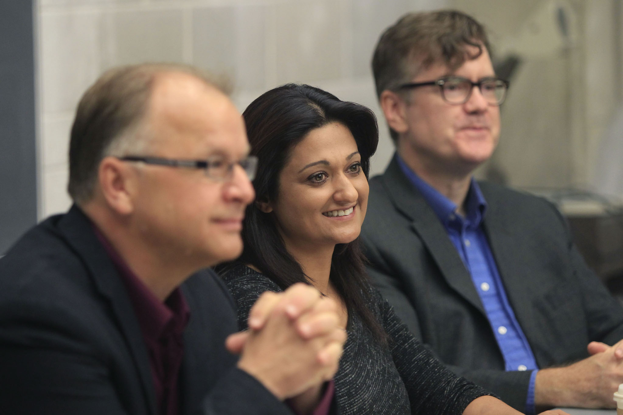 Manitoba Liberal candidates, from left, Bob Axworthy, Rana Bokhari and Dougald Lamont at the U of W today.