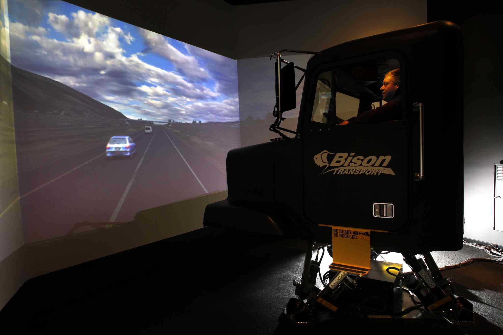Eric Roeder, a driving instructor at Bison Transport, takes a spin in the tractor-trailer simulator.