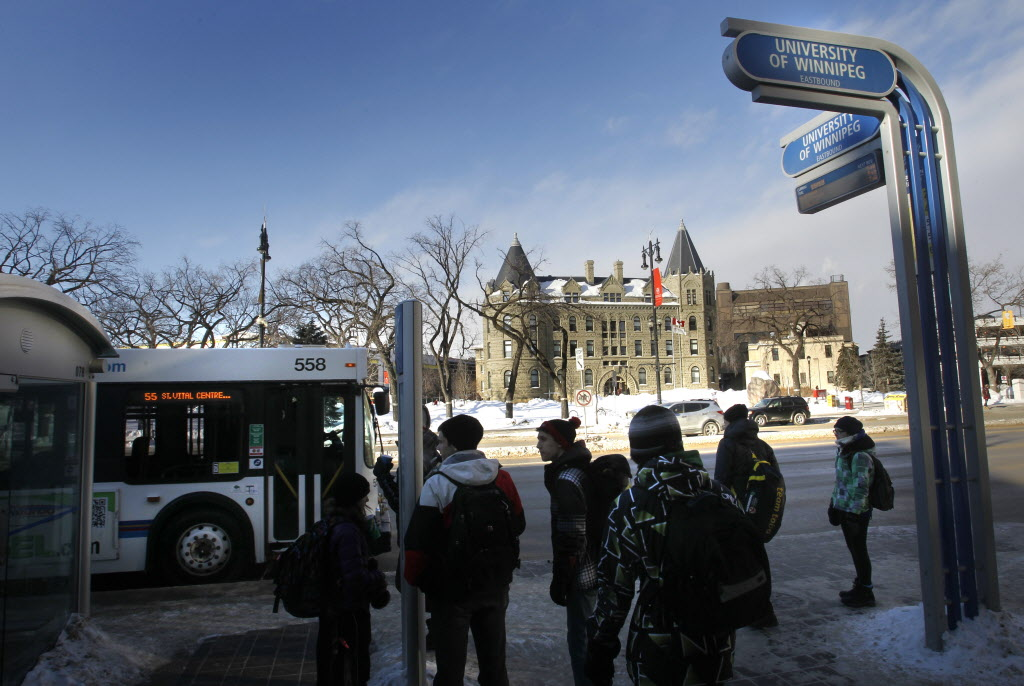 Students wait for a bus across from the University of Winnipeg.