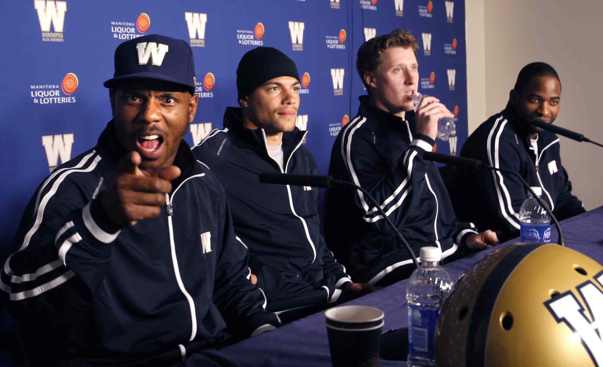 Three of the newest Blue Bombers met the media Thursday. From left: defensive back Korey Banks, wide receiver Nick Moore, quarterback Drew Willy and Bombers veteran wide receiver Cory Watson.