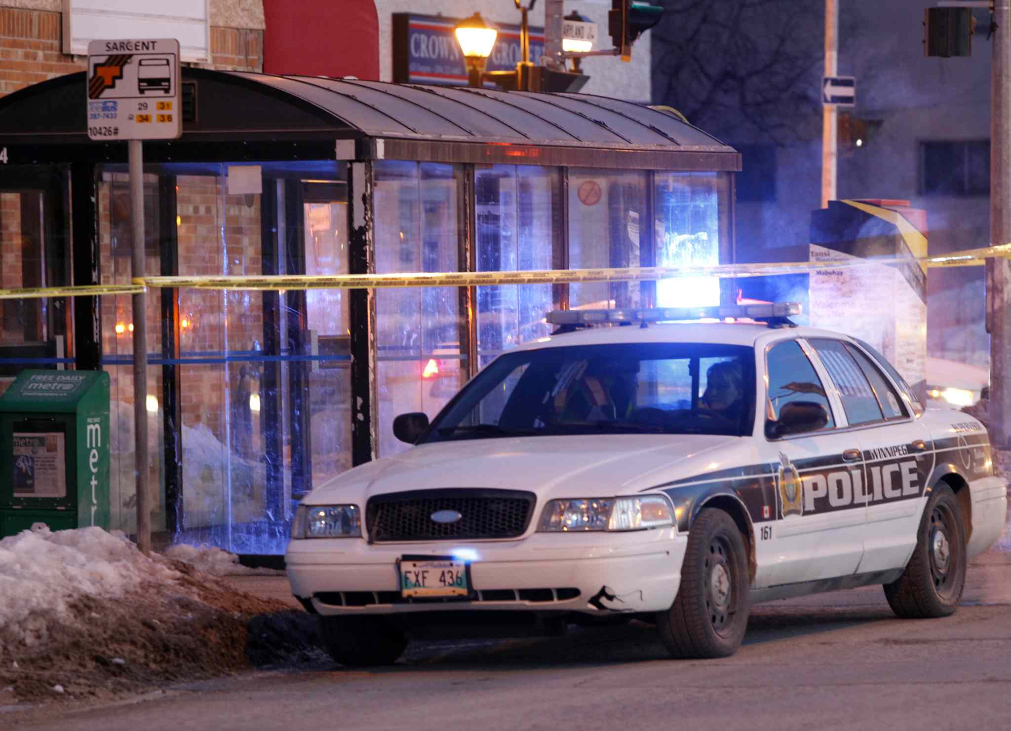 Two police cars parked at the intersection of  Maryland Street and Sargent Avenue along side a Transit bus shelter that is taped off Tuesday morning.