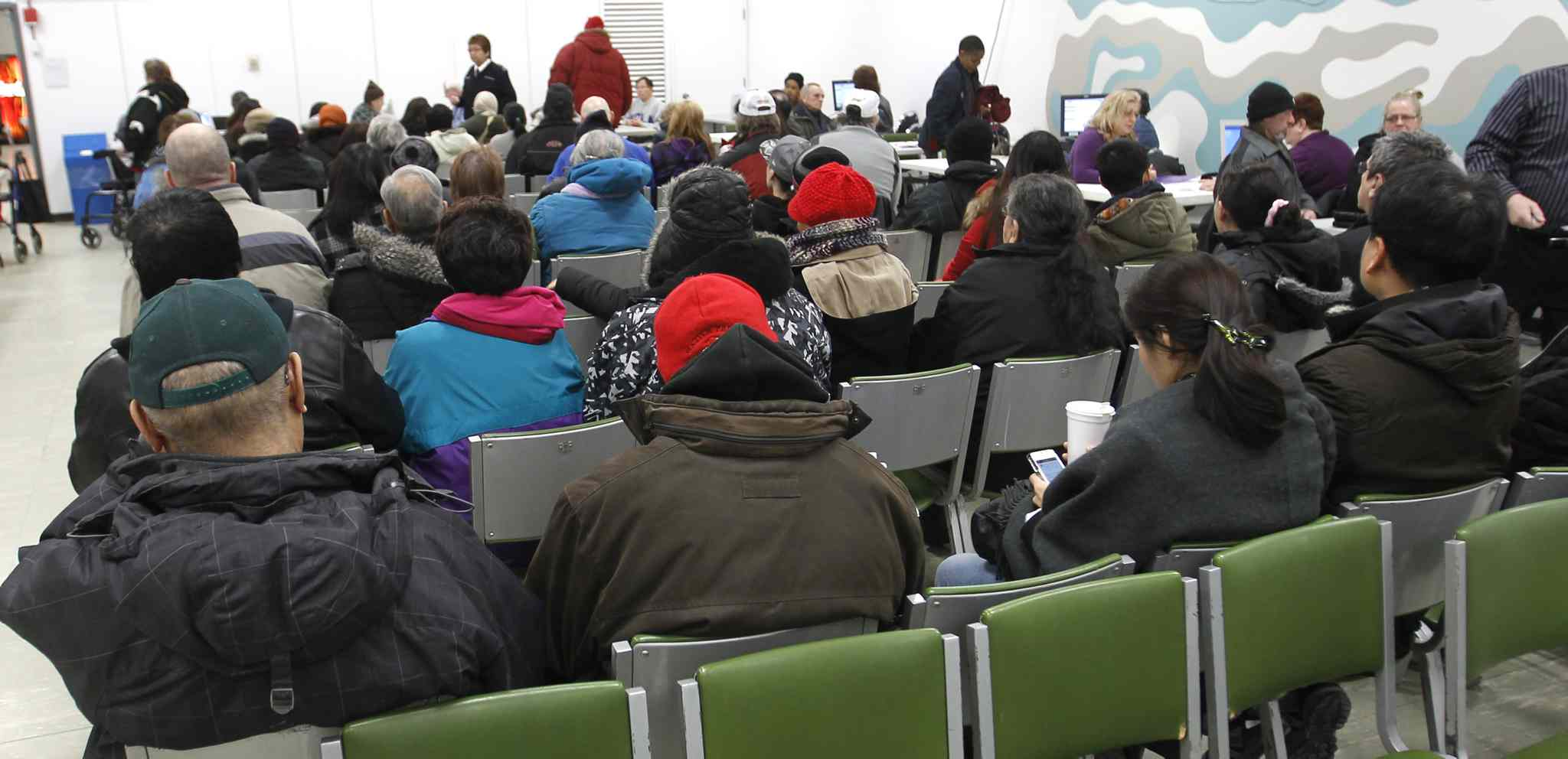Dozens of low-income Winnipeggers wait in the Norquay Building to have their taxes prepared by the non-profit Community Financial Counselling Service, which makes sure they maximize their refunds.