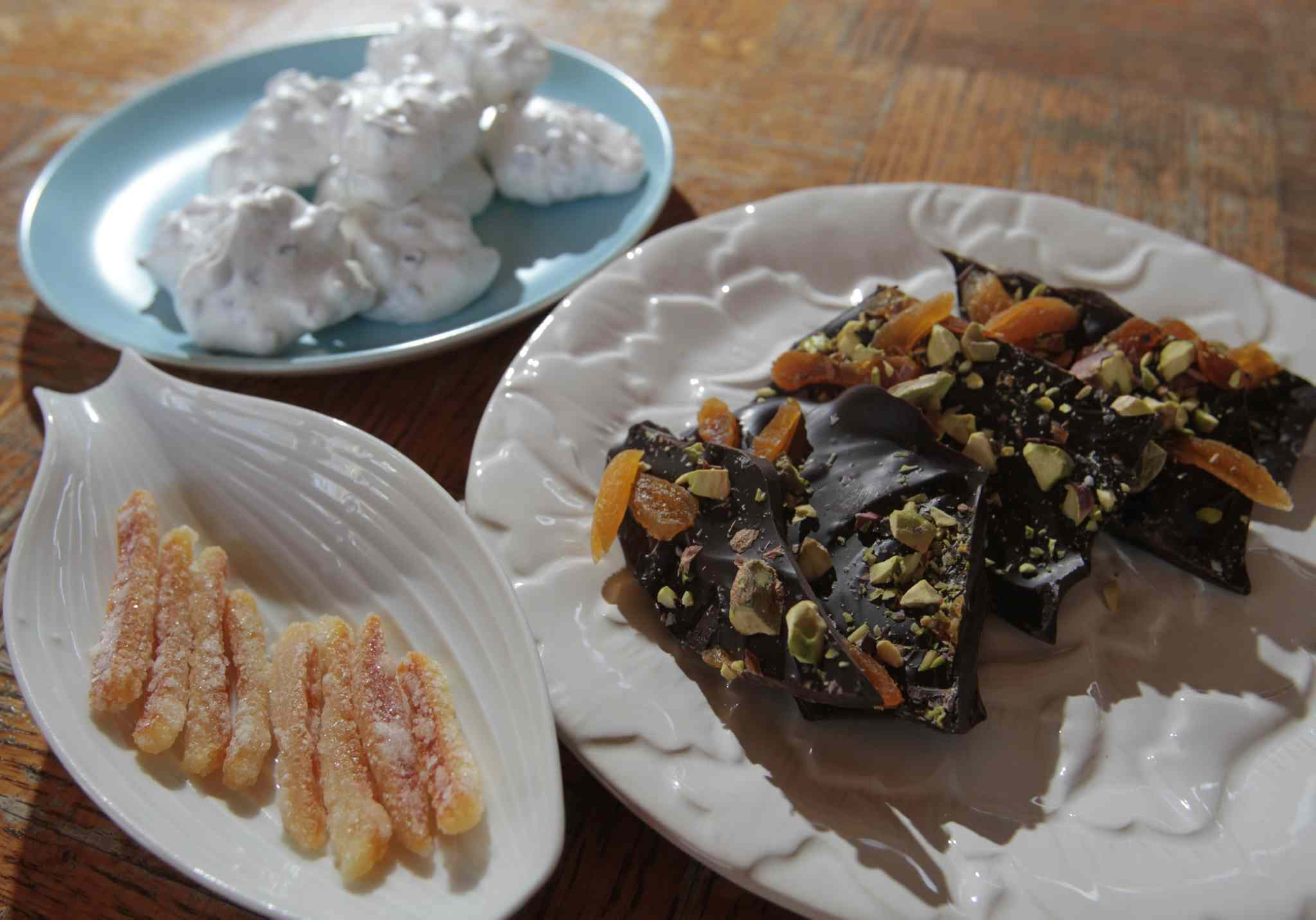 Dark Chocolate Bark (on white plate),  Forgotten Kisses (on blue plate) and Candied Orange Peel (on leaf shaped dish.)