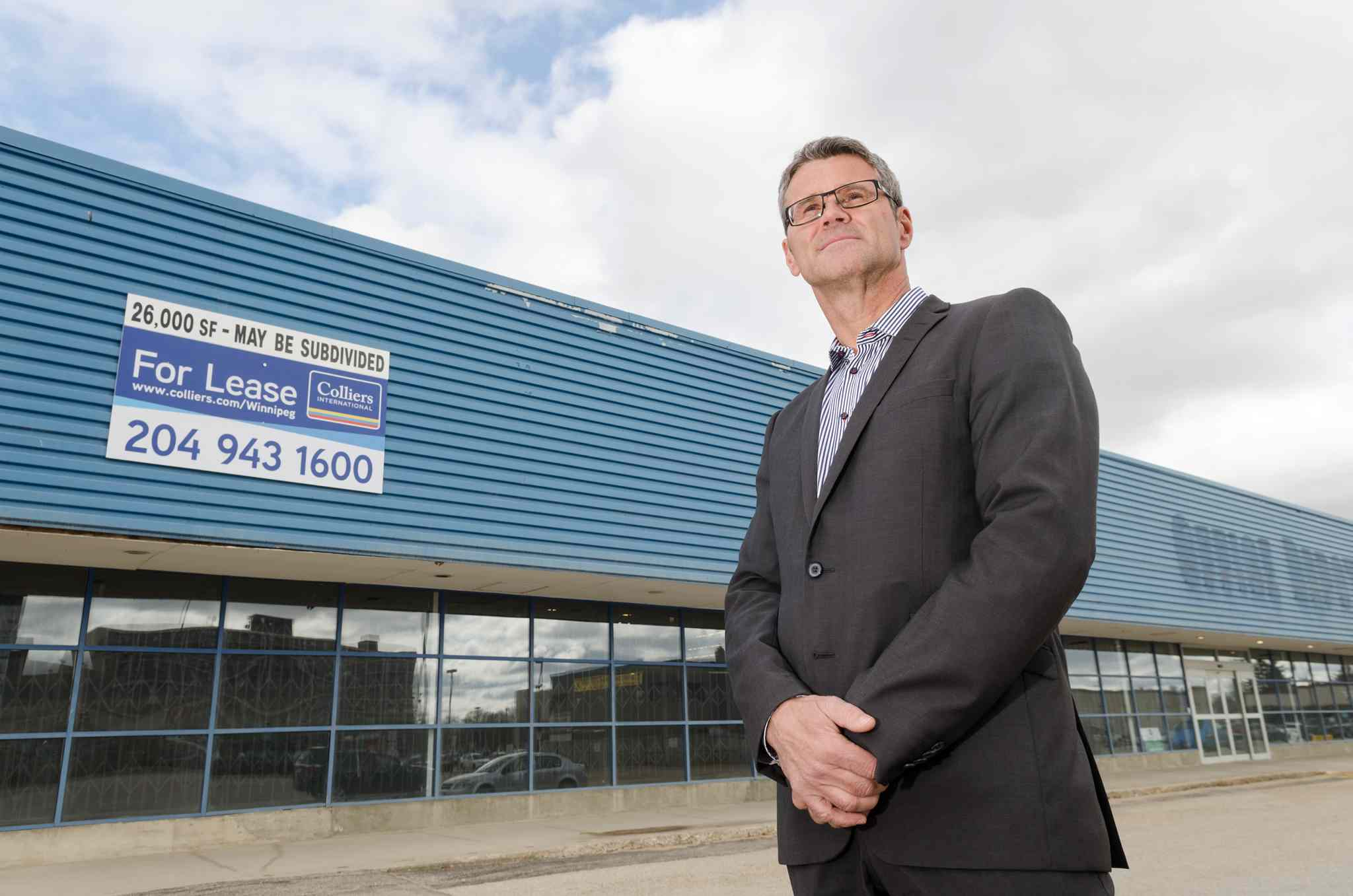 John Prall of Colliers International outside the vacant former Office Depot at Madison Square, bought for redevelopment by the Toronto-based Strathallen Acquisition Corp.