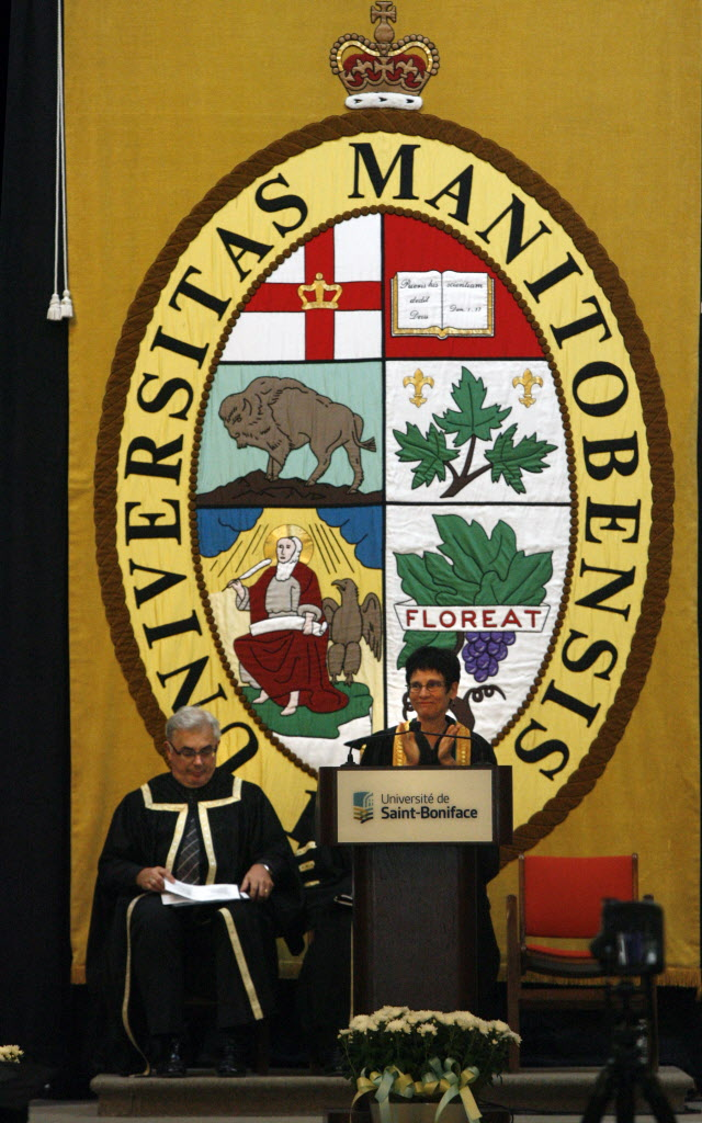 Raymonde Gagne, pres. of the  Universite de Saint-Boniface beside seated Dr. David Barnard, pres. and Vice-Chancellor of the University of Manitoba addresses the graduating class of Universite de Saint-Boniface in the Saint Boniface Cathedral Monday at the University of Manitoba Convocation.