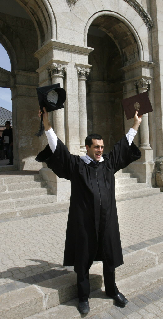 Joel Caby in the graduating class of Universite de Saint-Boniface, he poses for family photos after he received his Bachelor of Arts Degree at the University of Manitoba Convocation.