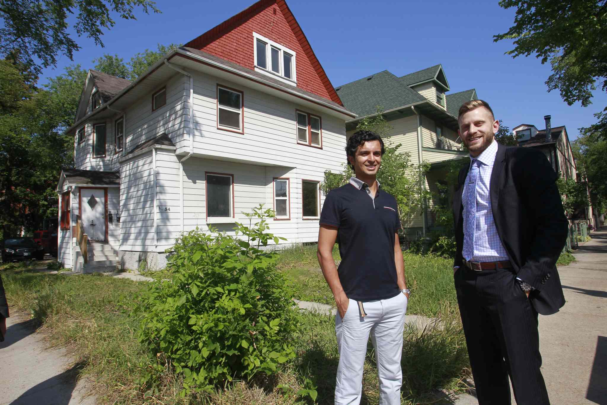 Martin Riazuddin (left) and Jon Blumberg in front of 54 Maryland St. A new condo/commercial development is planned for the site.
