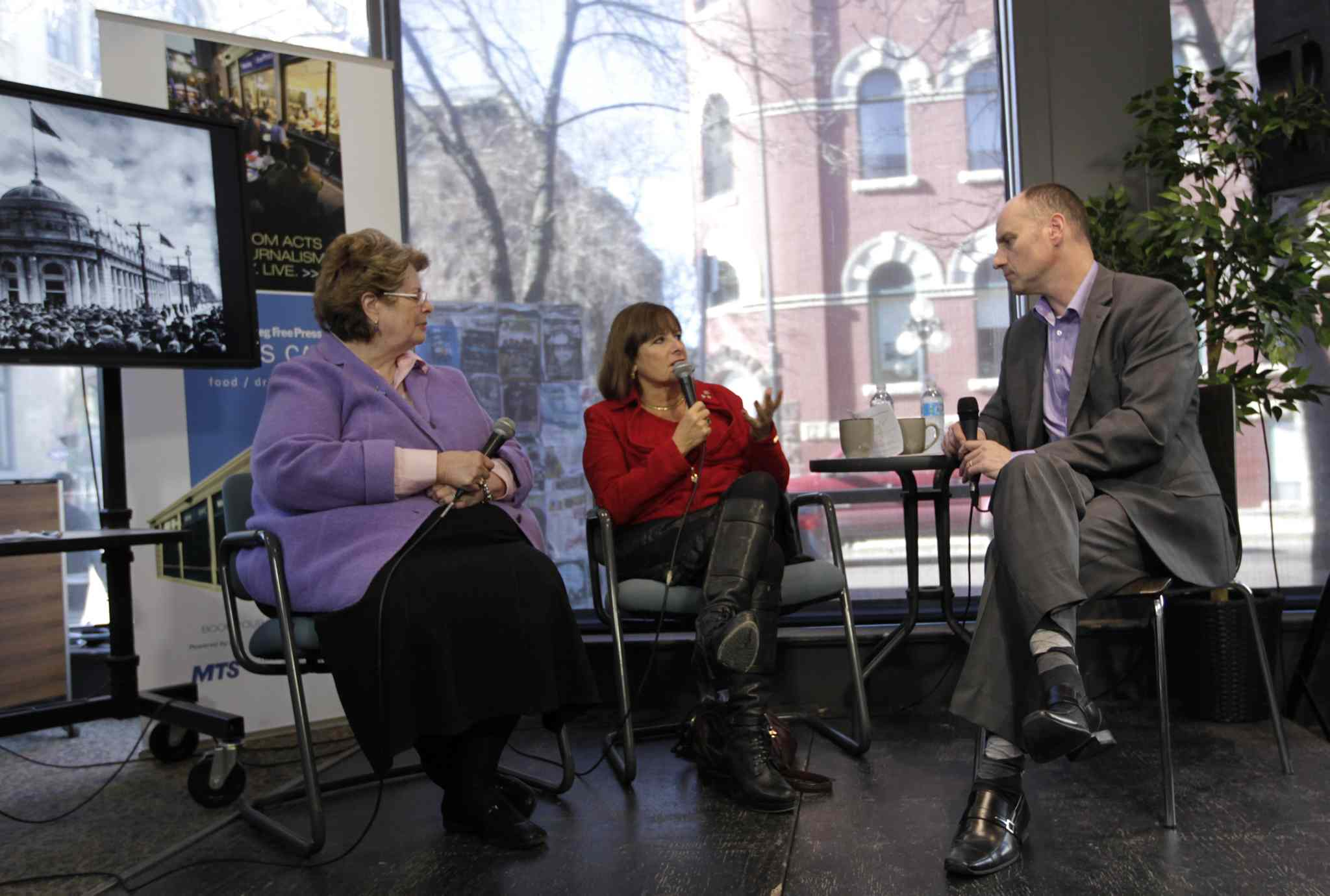 Editor Paul Samyn moderates City Beautiful panel at the News Café Monday with Susan Thompson (left) and Gail Asper.