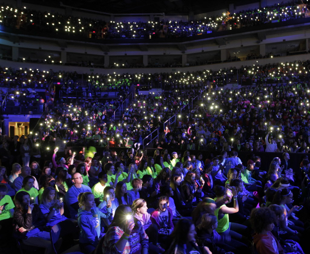 About 16,000 students attending the We Day event Wednesday light up the their cell phones at the MTS Centre.    (Wayne Glowacki / Winnipeg Free Press )