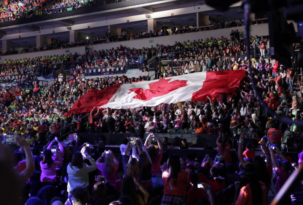 A Canadian flag is passed around the MTS Centre by Manitoba students at the We Day event. (Wayne Glowacki / Winnipeg Free Press)