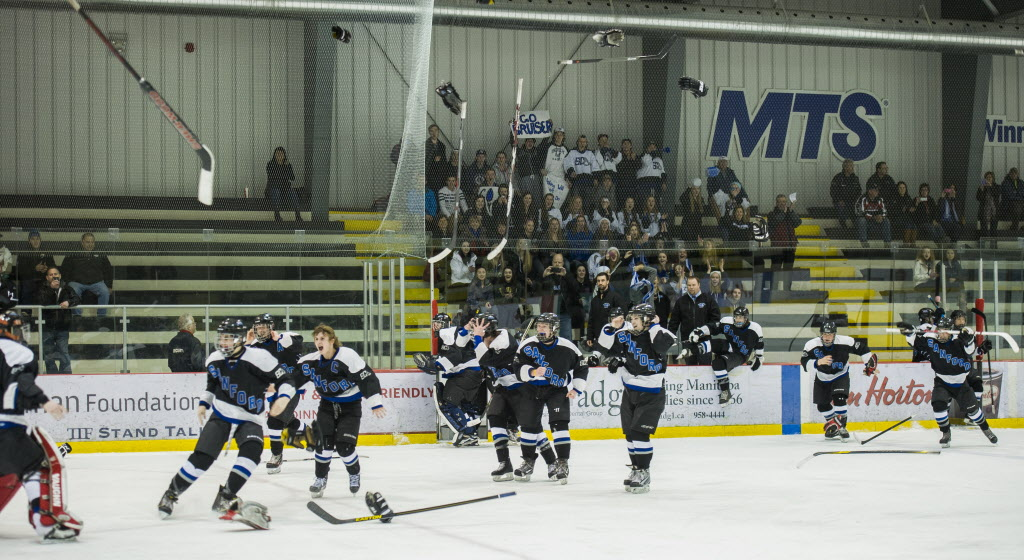 The Sanford Sabres celebrate their win over the Lord Selkirk Royals after their Winnipeg High School hockey league championship game at the MTS Iceplex Wednesday afternoon. (DAVID LIPNOWSKI / WINNIPEG FREE PRESS)