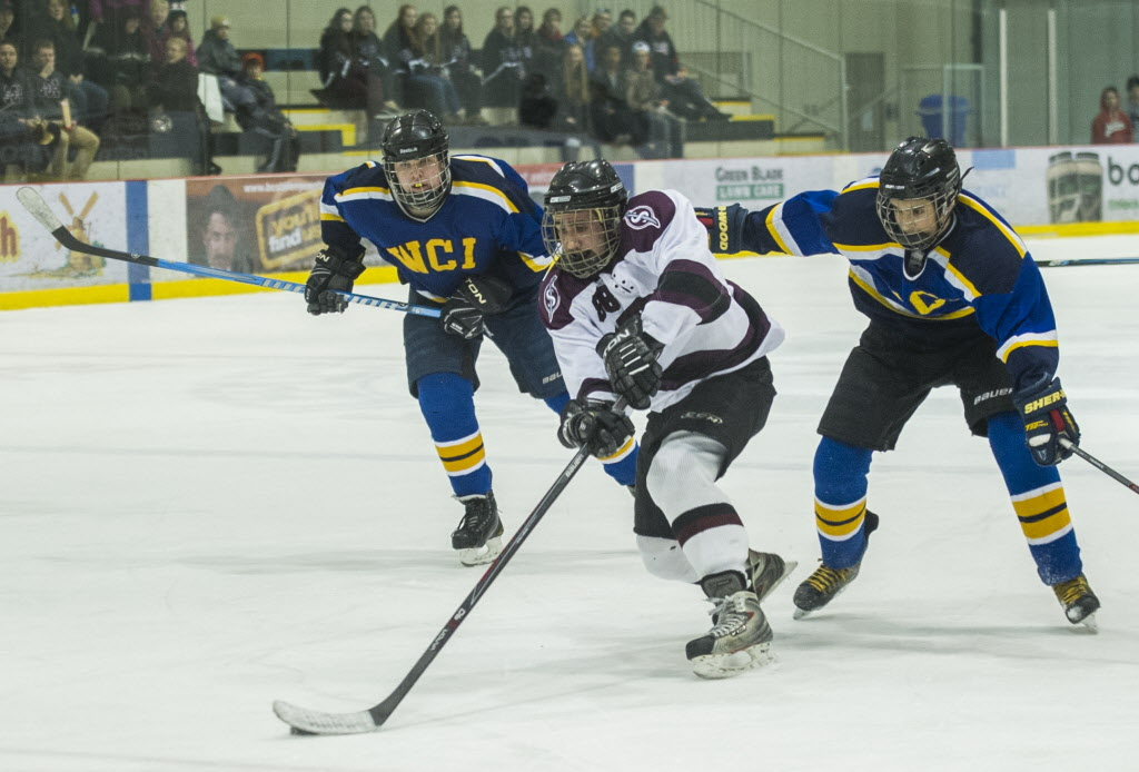 Springfield Sabres Austin Charles (#88) battles the Warren Wildcats during their Winnipeg High School Hockey League game at the MTS Iceplex Wednesday afternoon. The teams will play for the trophy on Thursday March 13. (DAVID LIPNOWSKI / WINNIPEG FREE PRESS)