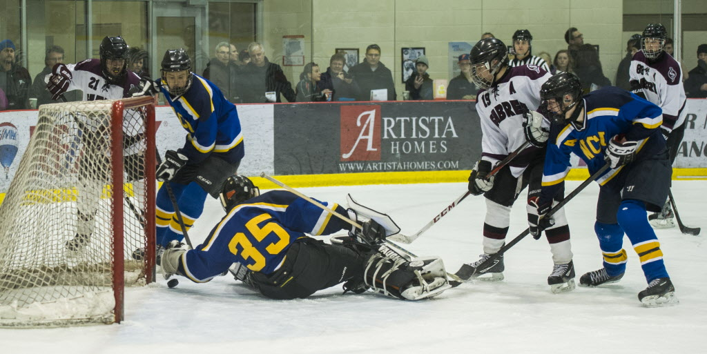 Warren Wildcats goal tender (no name on roster, #35) tries to stop a shot from the Springfield Sabres during their Winnipeg High School Hockey League game. (DAVID LIPNOWSKI / WINNIPEG FREE PRESS)