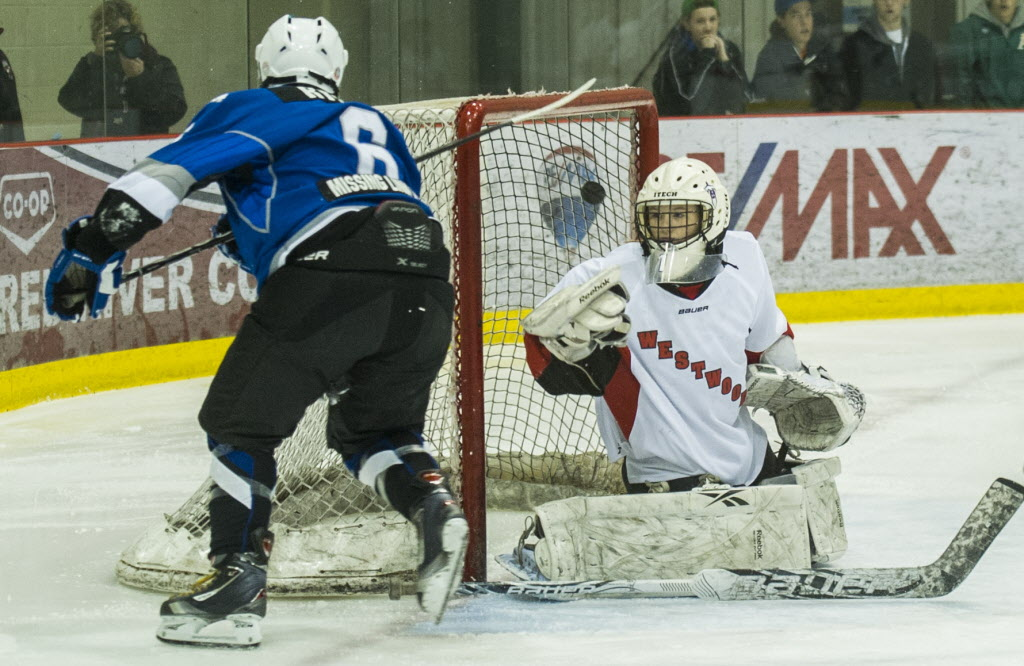 Selkirk Royals Rochelle Ryder scores against the Westwood Warriors during their Women's Winnipeg High School Hockey League championship game at the MTS Iceplex Wednesday afternoon. The Warriors won the game.