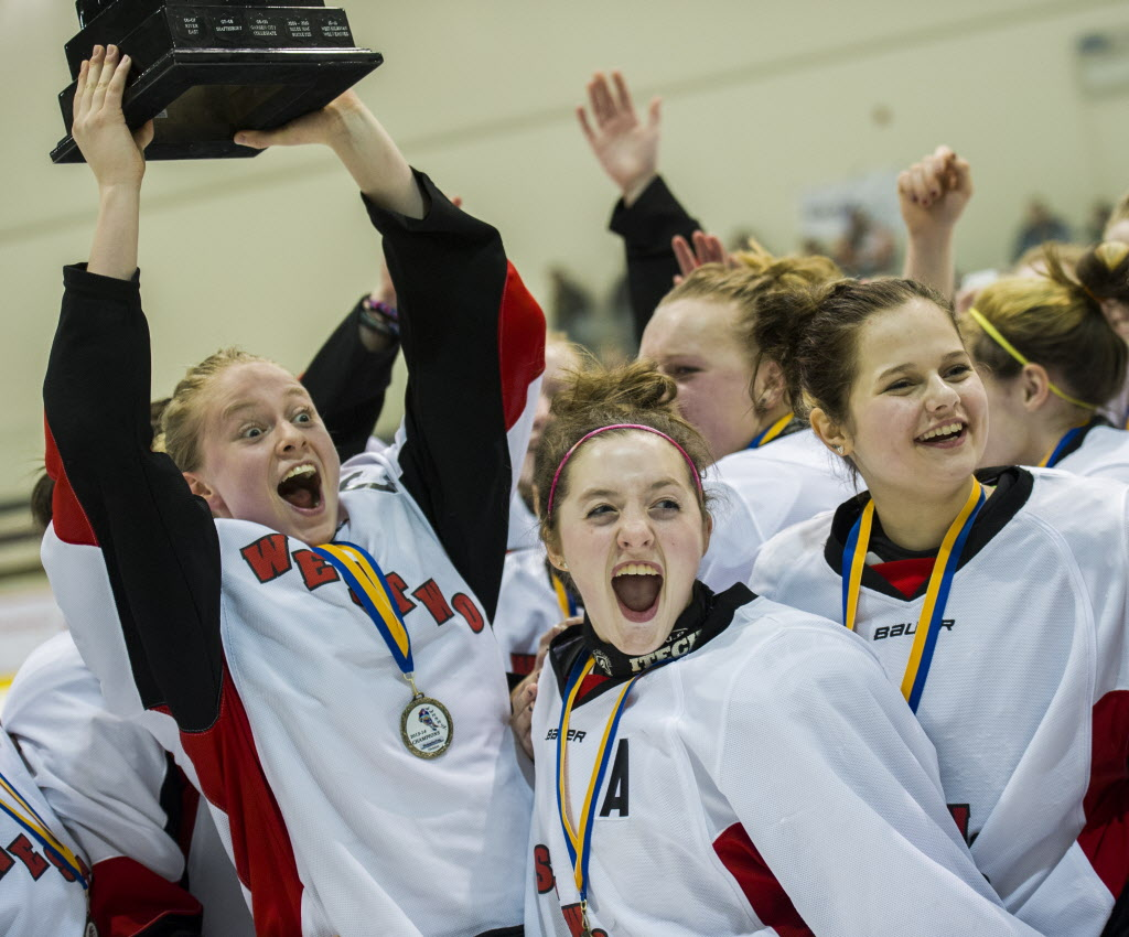 The Westwood Warriors celebrates winning the championship game over the Selkirk Royals after their Women's Winnipeg High School Hockey League championship game.