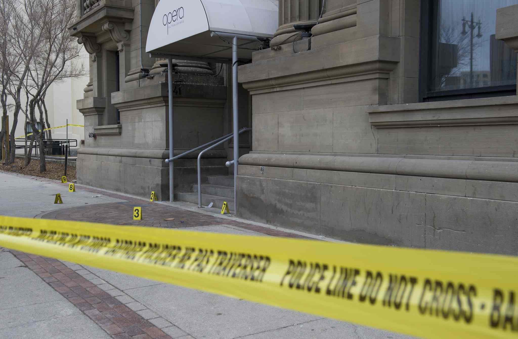 Police tape and evidence markers on Main Street outside the Opera Ultralounge nightclub.