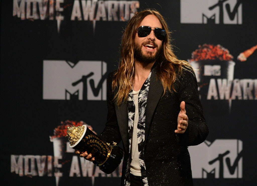 """Jared Leto poses in the press room with the award for Best On-Screen Transformation for """"Dallas Buyers Club"""" at the MTV Movie Awards on Sunday, April 13, 2014, at Nokia Theatre in Los Angeles."""