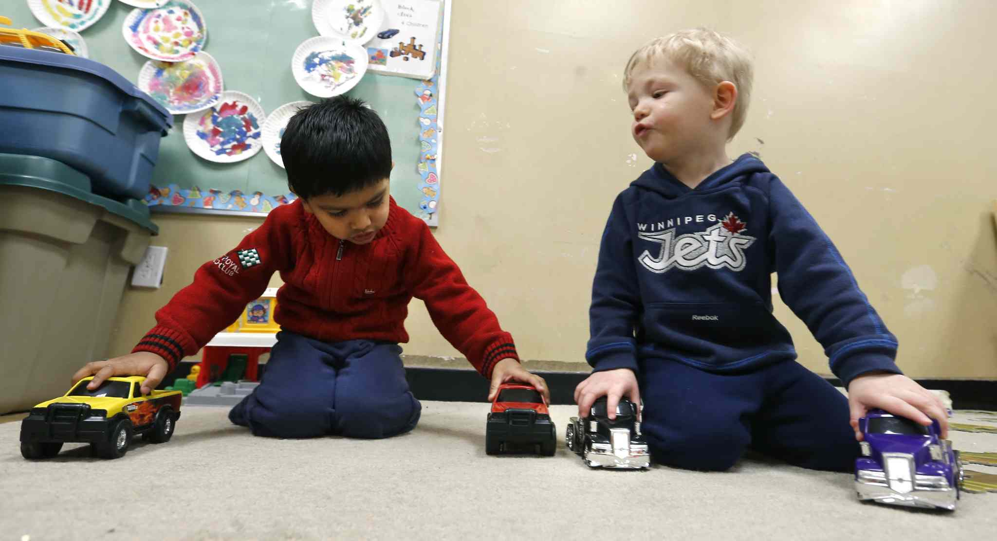 Fateh (left) and Daniel play in a Winnipeg daycare. Moms without a place for their kids frequently struggle to work.