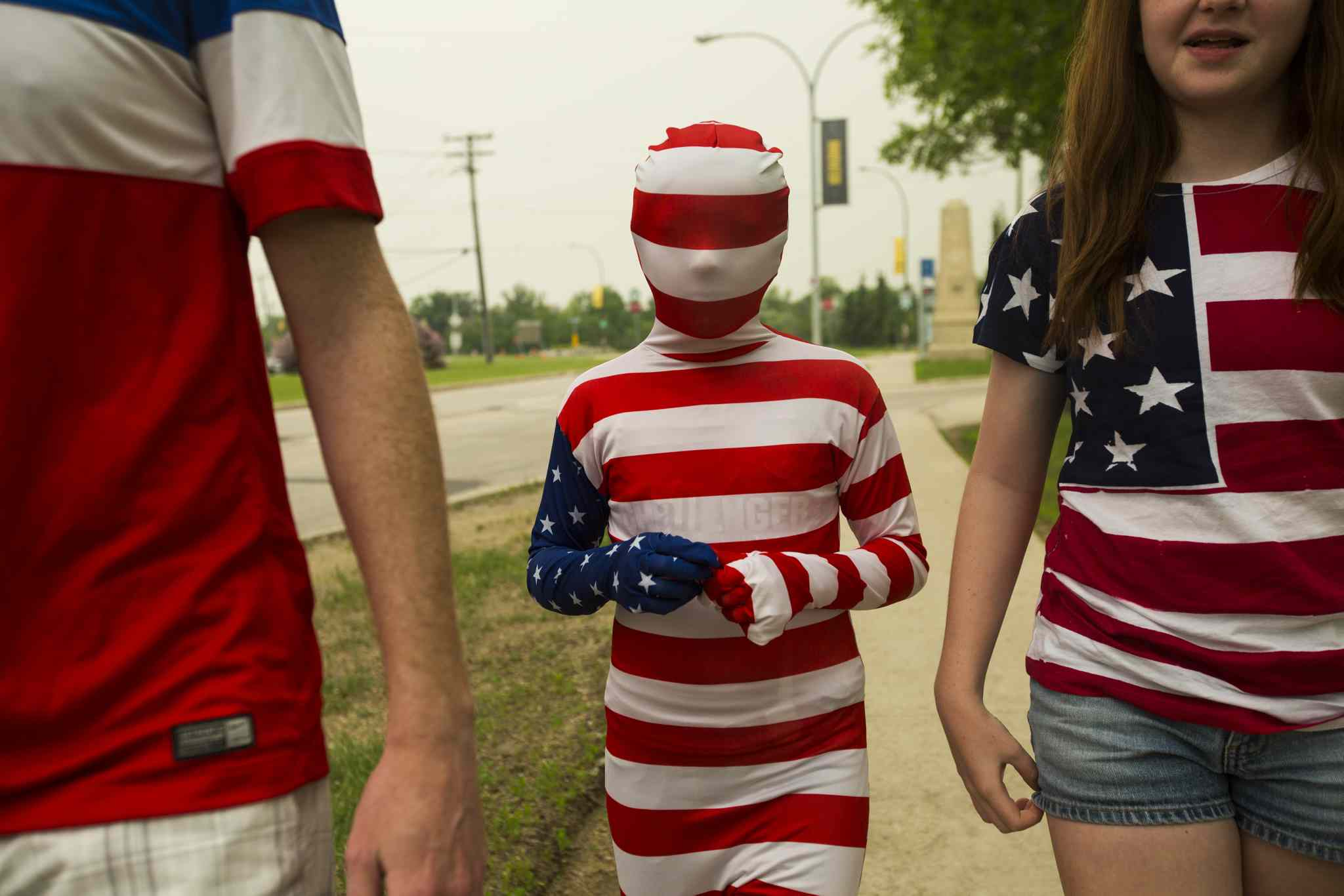 Giuliana Weber, 9, walks to the stadium in a full-body costume to see the Nigeria vs. Sweden match at the FIFA women's world cup on Monday, June 8, 2015.  The Weber family is from Nebraska, and spent three hours at the border on the way to Winnipeg.
