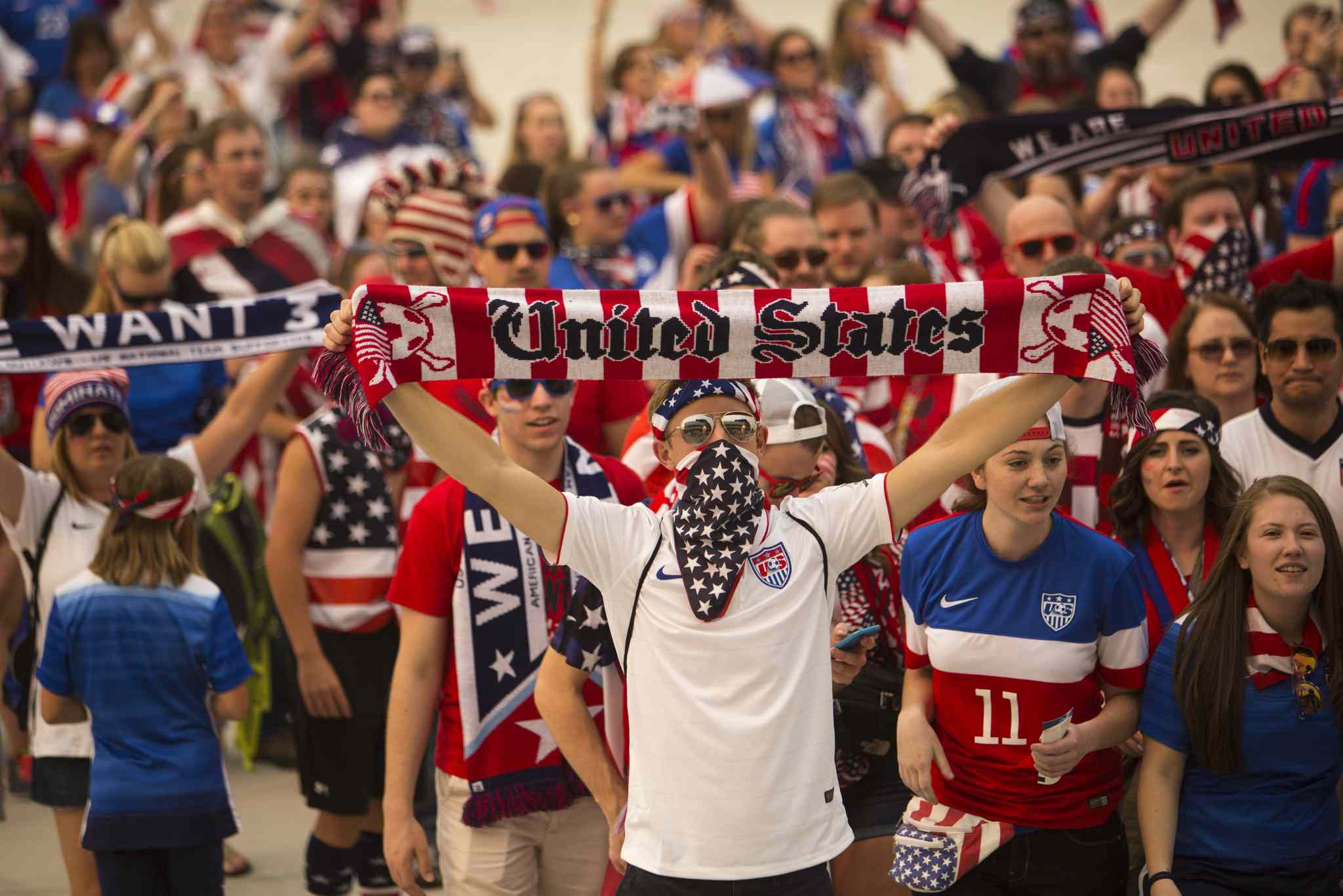 Members of the soccer fan group the American Outlaws march up to the stadium to see the FIFA World Cup United States vs. Australia game at the Investors Group Field on Monday, June 8, 2015.