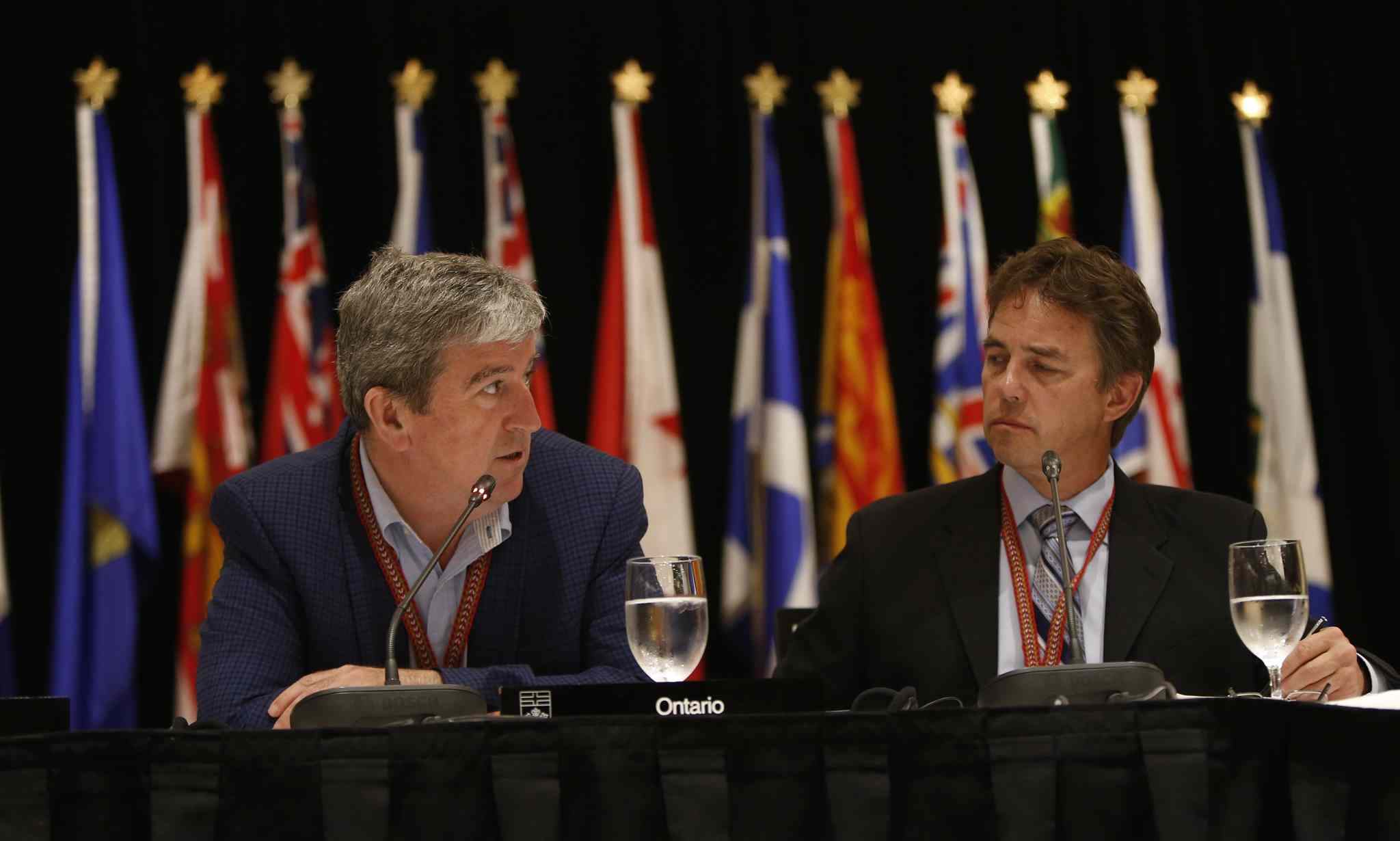 Manitoba Conservation and Water Stewardship Minister Tom Nevakshonoff (right) with Ontario counterpart Glen Murray.