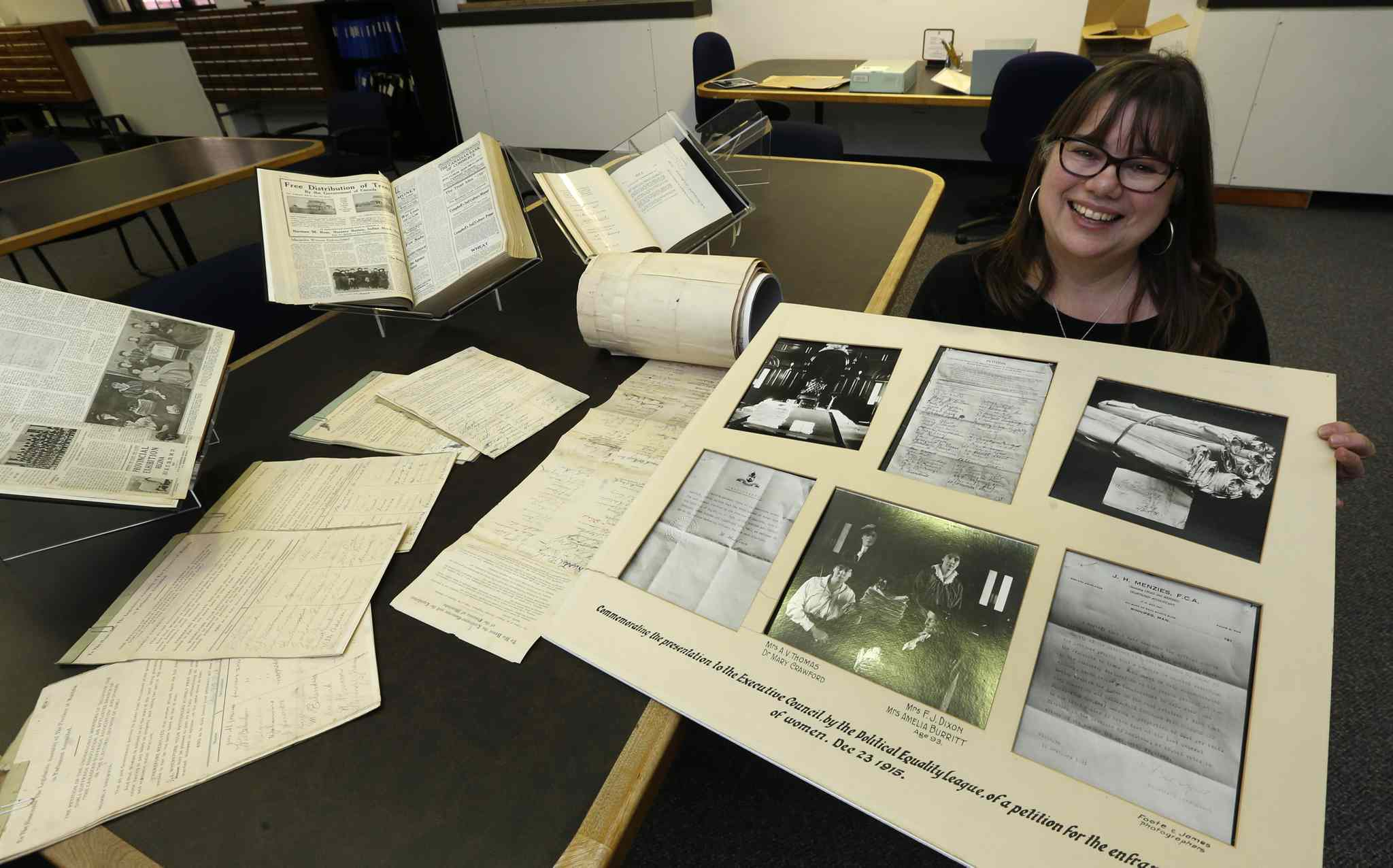 Kathleen Epp, senior archivist at the Archives of Manitoba, with some of the items that will be on display at the suffrage open house.