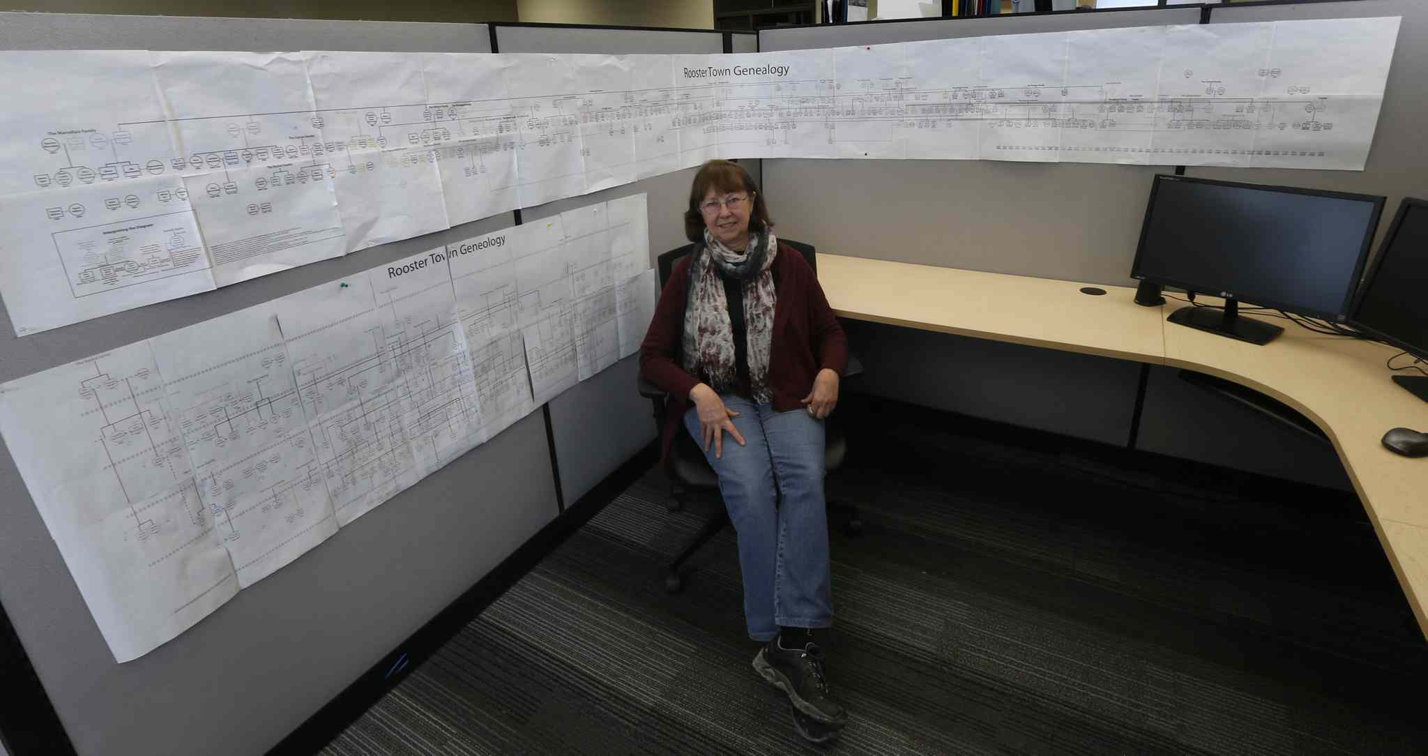 Evelyn Peters, a University of Winnipeg professor who has spent the last few years researching Rooster Town and its inhabitants, in a a research associate's office wrapped with a Rooster Town genealogy that spans 60 years.
