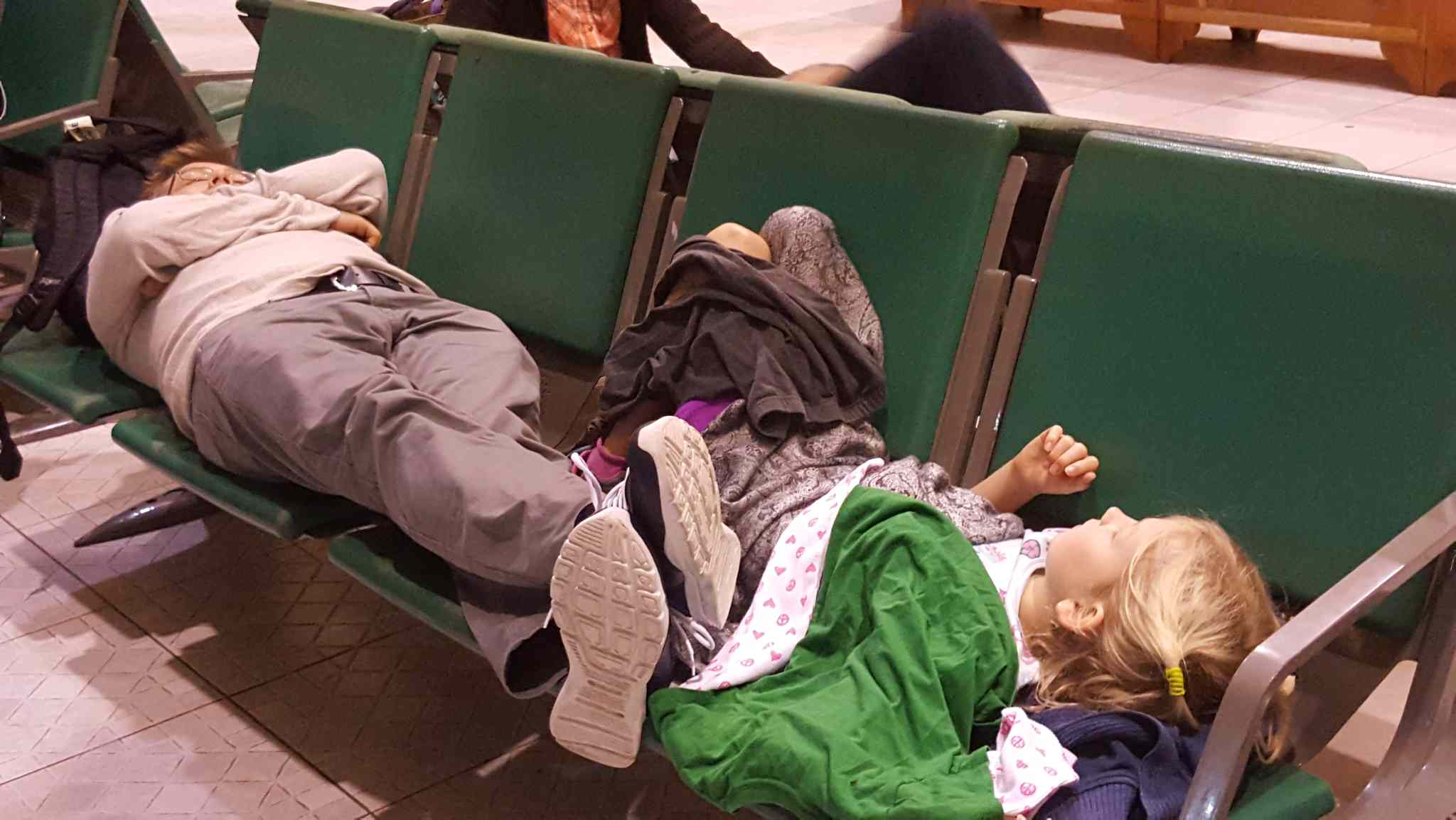 Passengers sleeping on seats at the airport in Cuba.