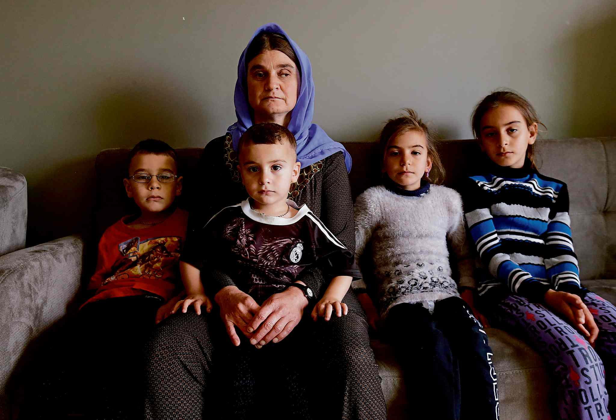 Nofa Mihlo Rafo with her children from left, Maher, Rebar, Vian and Eman in Winnipeg. The Yazidi refugee family was recently sponsored by the government to begin a new life here was contacted last week by a cousin who spotted one of her two missing sons on social media after he was freed from IS.