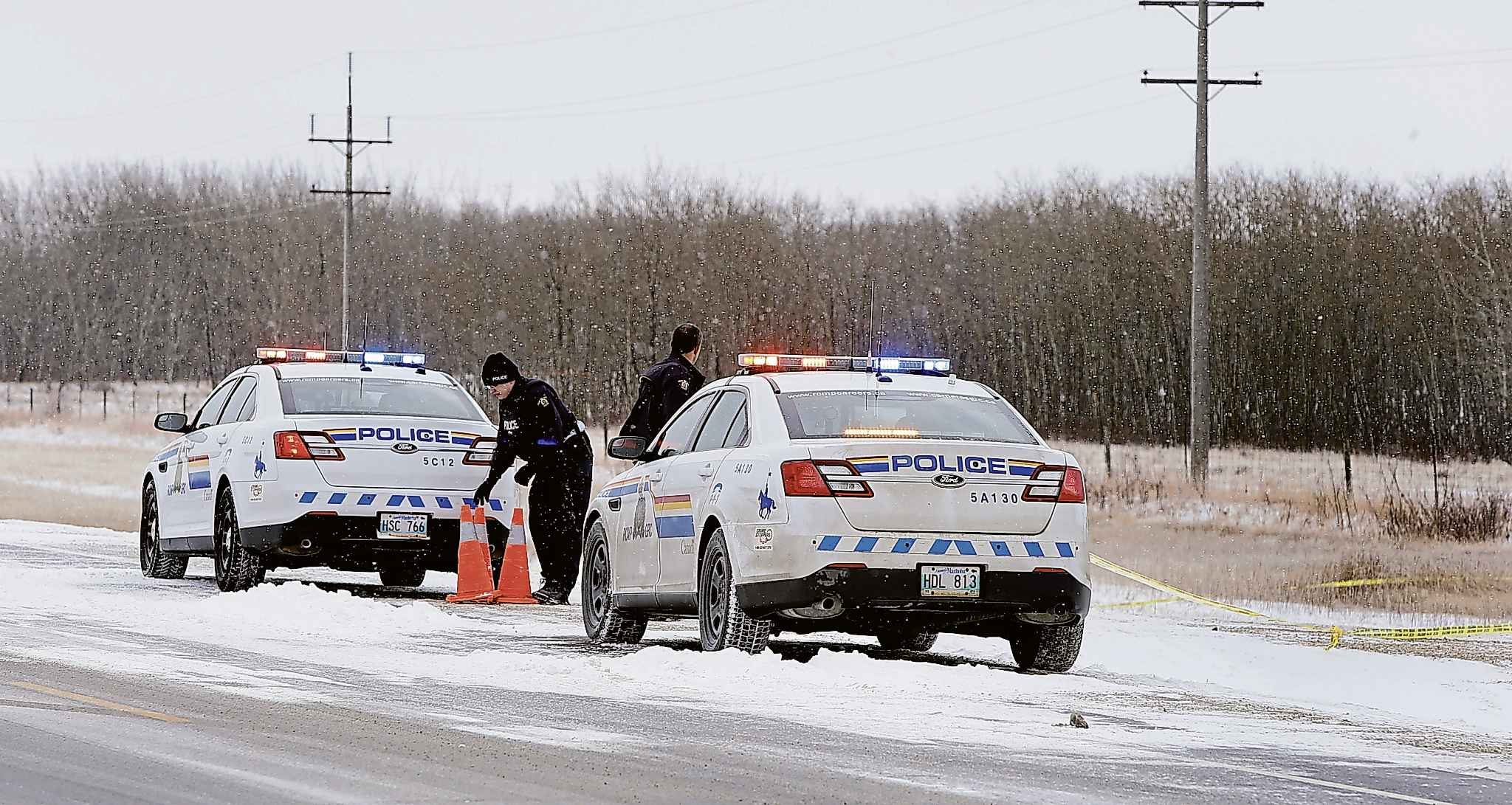 RCMP officers at a taped-off scene on Highway 6.