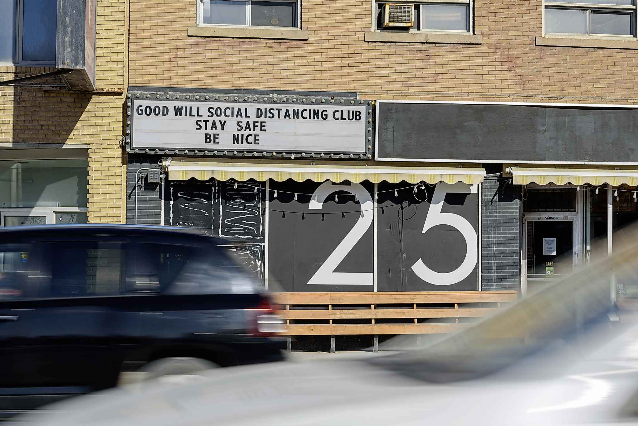 JESSE BOILY / WINNIPEG FREE PRESS  The Good Will Social Club promotes social distancing on their sign.
