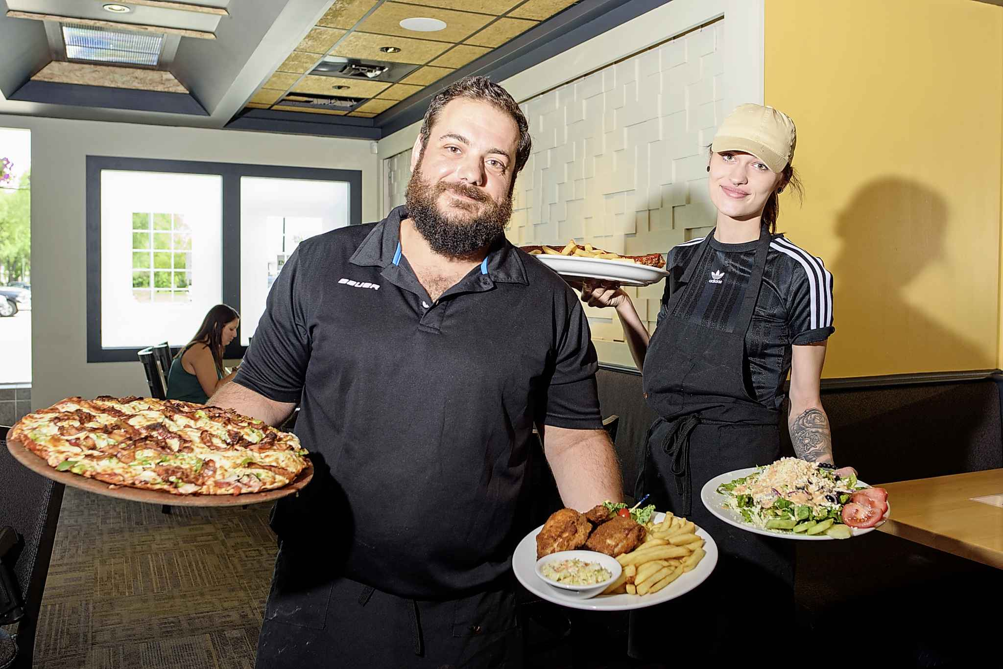 Giorgo Kodalonis, left, and Alicia Farr at Dal's Restaurant and Lounge.