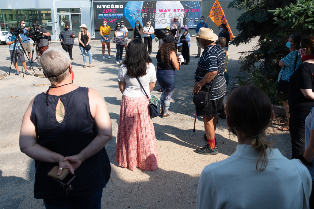 People gathered to bring awareness to what they say is Peter Nygard's legacy of sexual abuse outside of Peter Nygard's Notre Dame property on Wednesday. (Jesse Boily / Winnipeg Free Press)