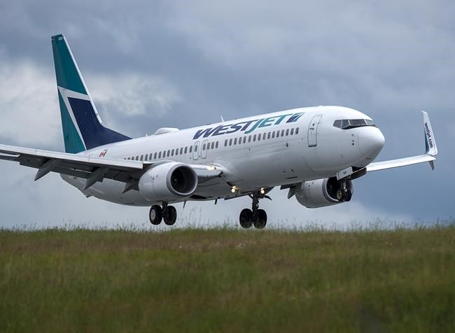 A WestJet flight from Calgary arrives at Halifax Stanfield International Airport in Enfield, N.S., Monday, July 6, 2020. WestJet Airlines Ltd. is now offering refunds to customers with European flights that it cancelled due to the COVID-19 pandemic. THE CANADIAN PRESS/Andrew Vaughan