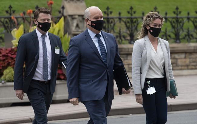 Conservative Leader Erin O'Toole walks to a caucus meeting in Ottawa with his chief of staff Tausha Michaud and campaign manager Fred DeLorey in Ottawa on Sept. 9, 2020. THE CANADIAN PRESS/Adrian Wyld