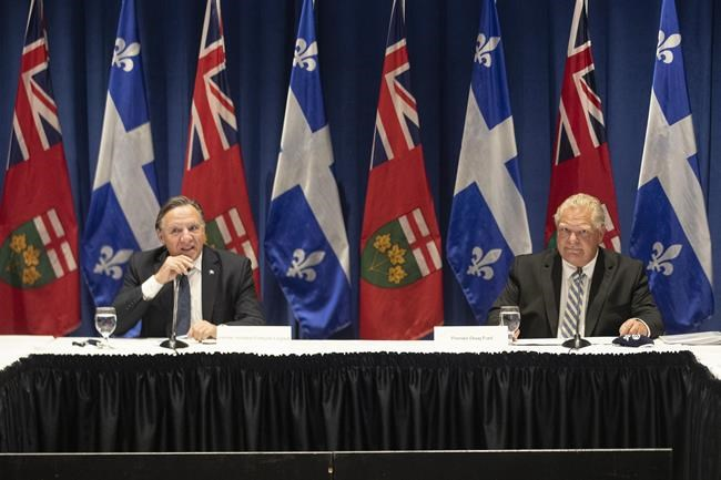 Ontario Premier Doug Ford, right, and Quebec Premier Francois Legault attend the Ontario-Quebec Summit, in Toronto, on September 9, 2020. THE CANADIAN PRESS/Chris Young