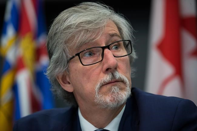 Privacy Commissioner of Canada Daniel Therrien listens during a news conference in Vancouver, Tuesday, Nov. 26, 2019. THE CANADIAN PRESS/Darryl Dyck