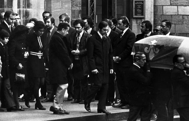 Mrs. Pierre Laporte (veiled) is escorted by her son Jean and daughter Claire as they follow the casket after funeral services for the Quebec Labour minister at Notre Dame Church in downtown Montreal Tuesday, Oct. 20, 1970. Mr. Laporte was kidnapped from his home Oct. 10 and killed a week later when ransom demands by the terrorist group Front de Liberation Quebec, FLQ, were not met. THE CANADIAN PRESS/Peter Bregg