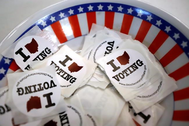 A bowl of stickers for those taking advantage of early voting is seen in Steubenville, Ohio, Sunday, March 15, 2020. THE CANADIAN PRESS/AP-Gene J. Puskar
