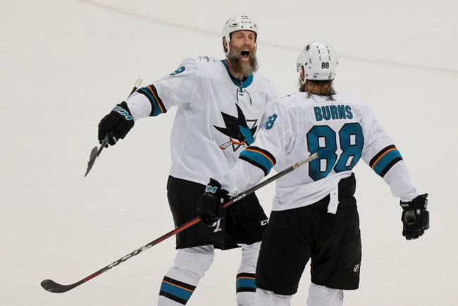 San Jose Sharks' Joe Thornton, left celebrates with Brent Burns (88) after Burns scored against the Pittsburgh Penguins during overtime in an NHL hockey game Thursday, Jan. 2, 2020, in Pittsburgh. The Toronto Maple Leafs have signed the 41-year-old Thornton to a one-year contract worth US$700,000. THE CANADIAN PRESS/AP-Keith Srakocic